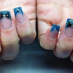 Blue glitter with crystal bow nail art