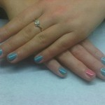 Blue mani-q with pink signature nail