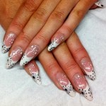 White stiletto tips with nail art